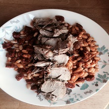 Roast Shoulder of Pork with Chorizo and Cannellini Beans
